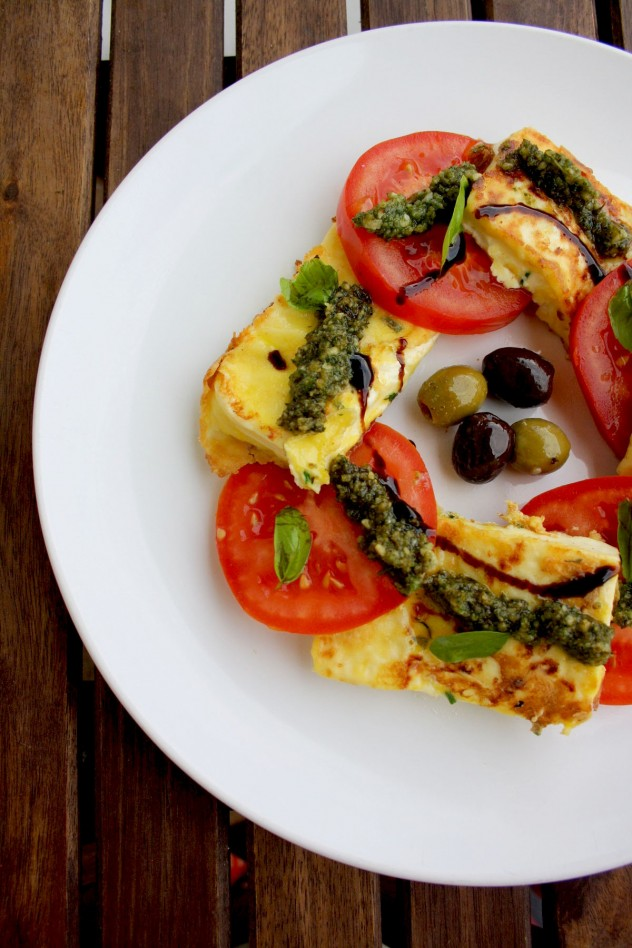Greek Feta Saganaki Caprese Salad Recipe - easy and incredibly delicious! Made of tomatoes, fried Greek feta saganaki cheese with pesto sauce and Balsamico.