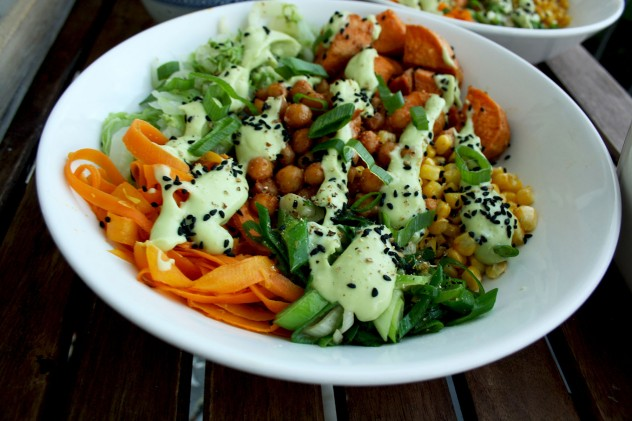 Healthy Veggie Bowls Recipe: Roasted Sweet Potatoes and Chick Peas with Stir Fried Napa Cabbage, Corn, Carrots and Scallions with Avocado Dressing.