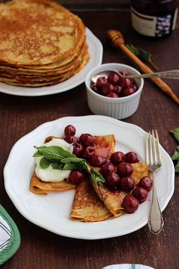 Russian Pancakes with Cherries on a Plate