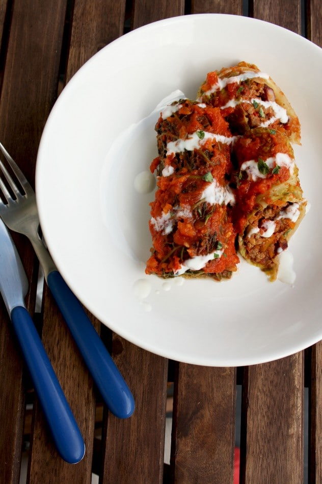 Mouthwatering, wholesome, flavorful and comforting fusion of Russian and American cuisine: Cabbage Rolls (Golubtsy) Stuffed with Chilli Con Carne. Great as a gluten-free make-ahead seasonal meal!