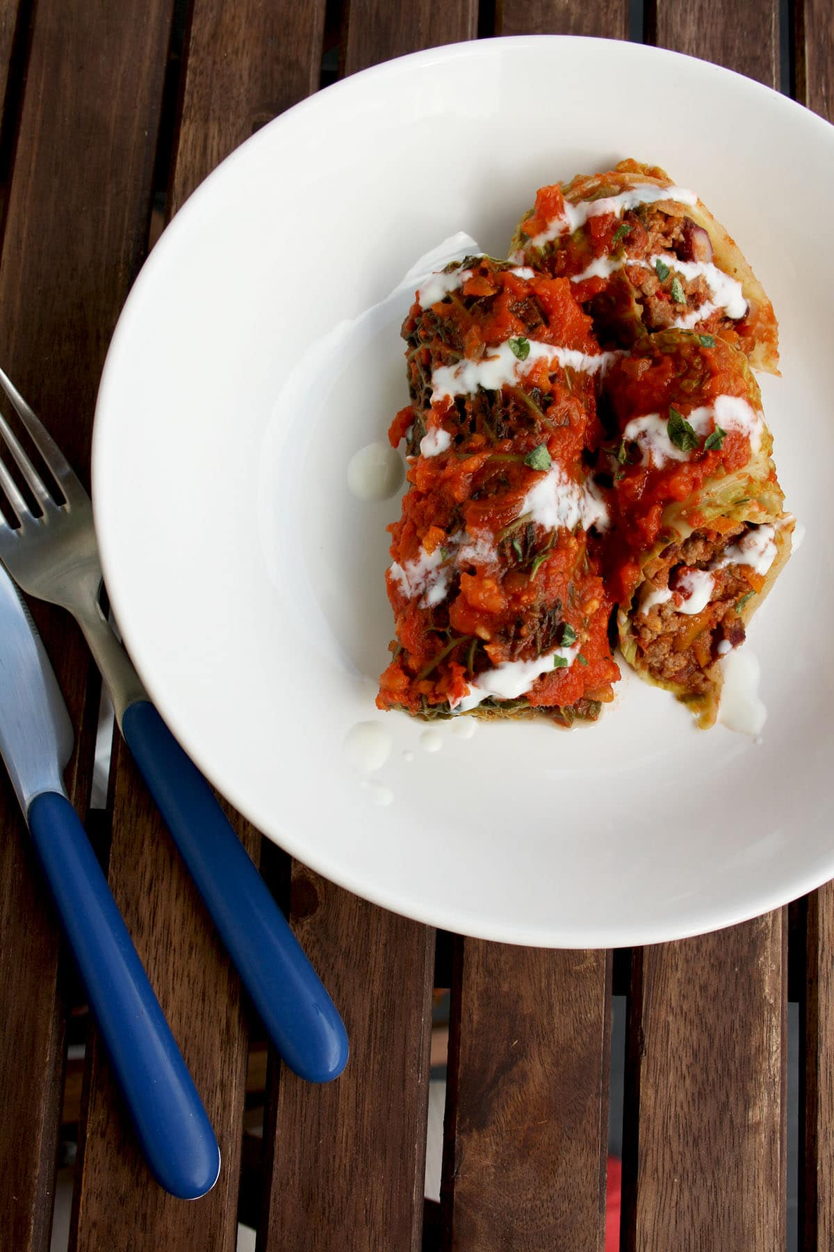 Mouthwatering, wholesome, flavorful and comforting fusion of Russian and American cuisine: Cabbage Rolls (Golubtsy) Stuffed with Chilli Con Carne. Great as a make-ahead seasonal meal!