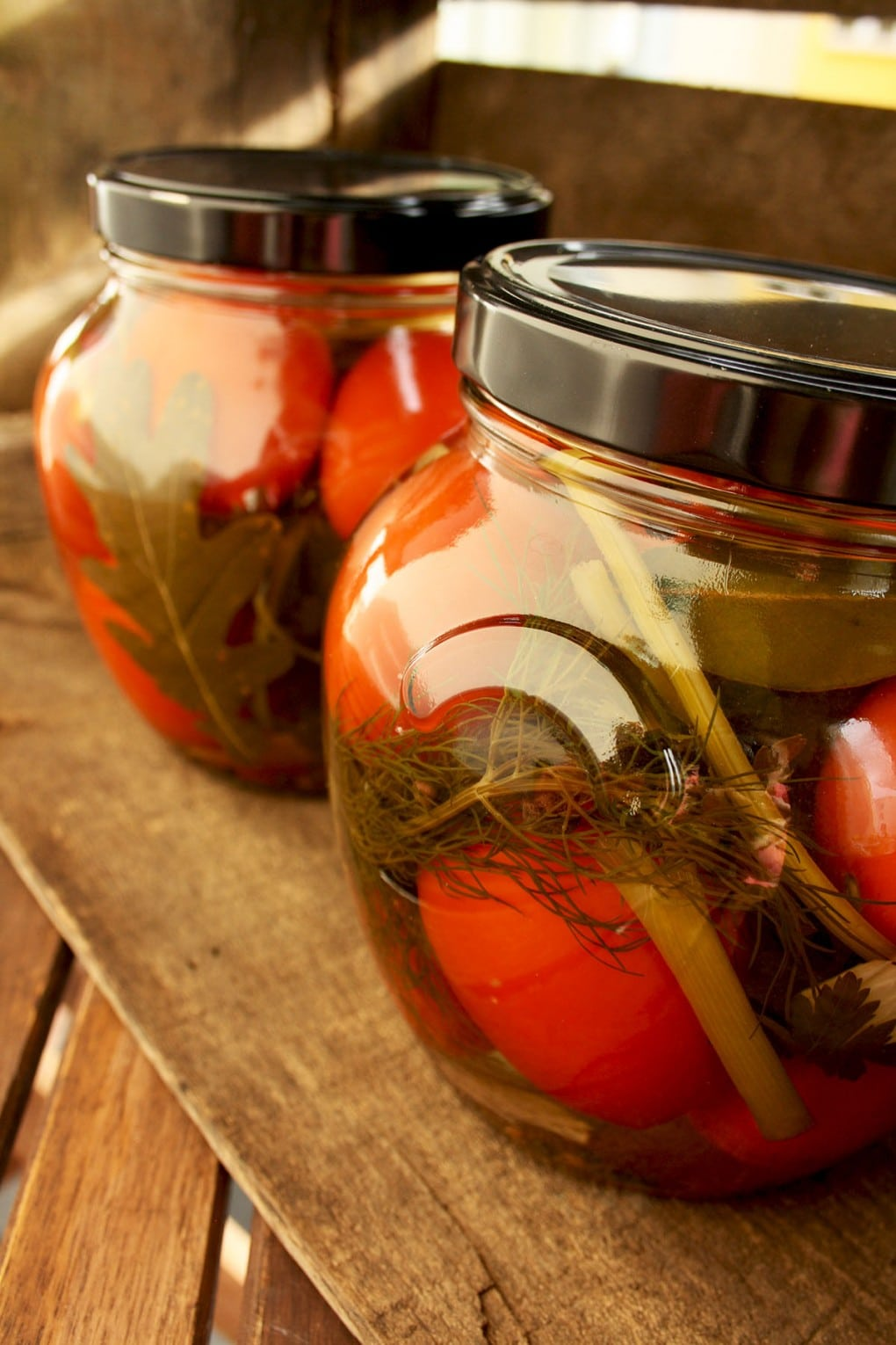 Russian Grandma's Pickled Tomatoes on the Wooden Table
