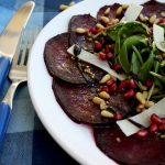 A beautiful, effortless, healthy and flavorful beetroot carpaccio with orange mustard vinaigrette and pomegranate seeds, served with parmesan and arugula.
