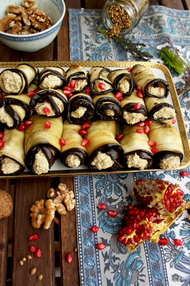 Georgian Eggplant Rolls with Pomegranate Arils on a Rectangular Serving Dish.