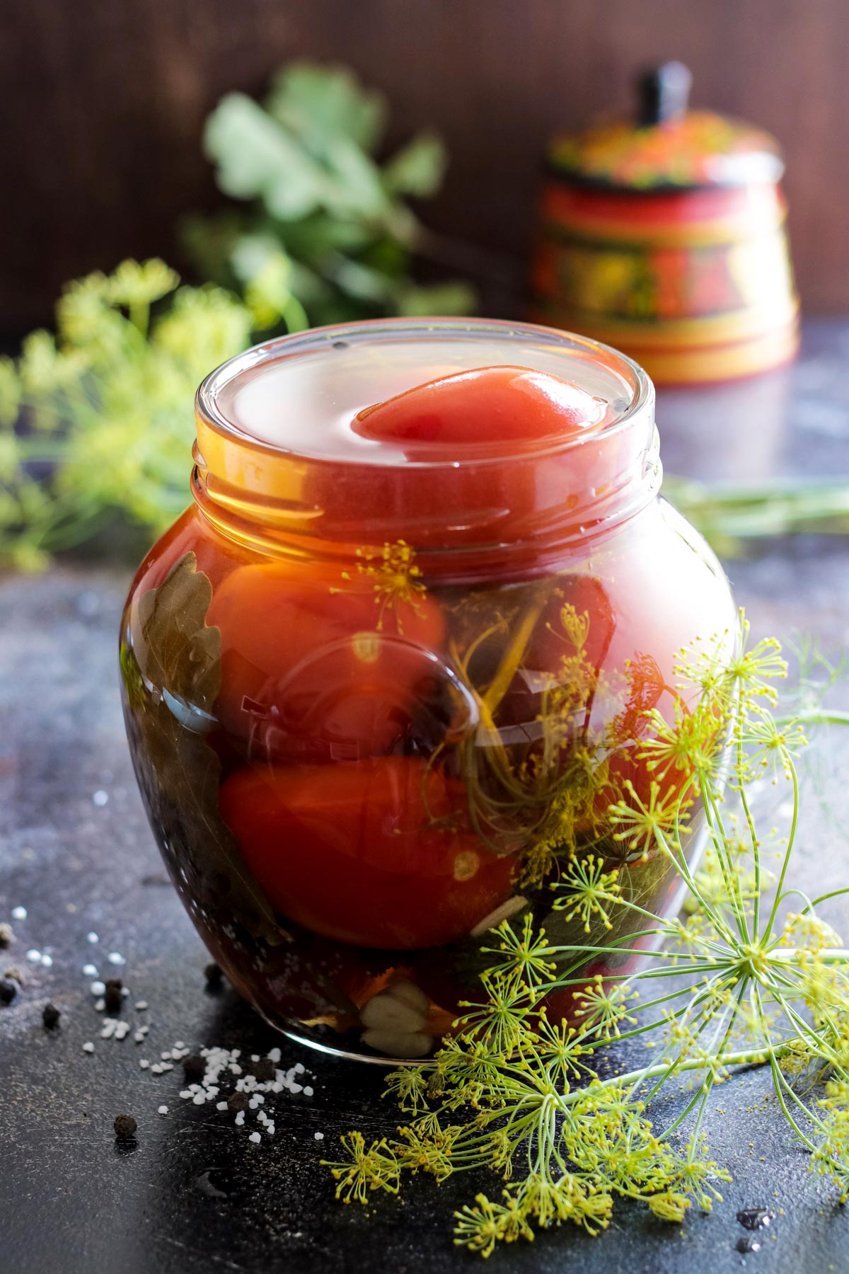 Opened jar with pickled tomatoes.