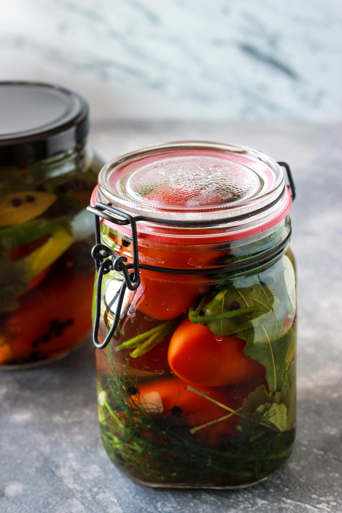 Pickled tomatoes in a jar.