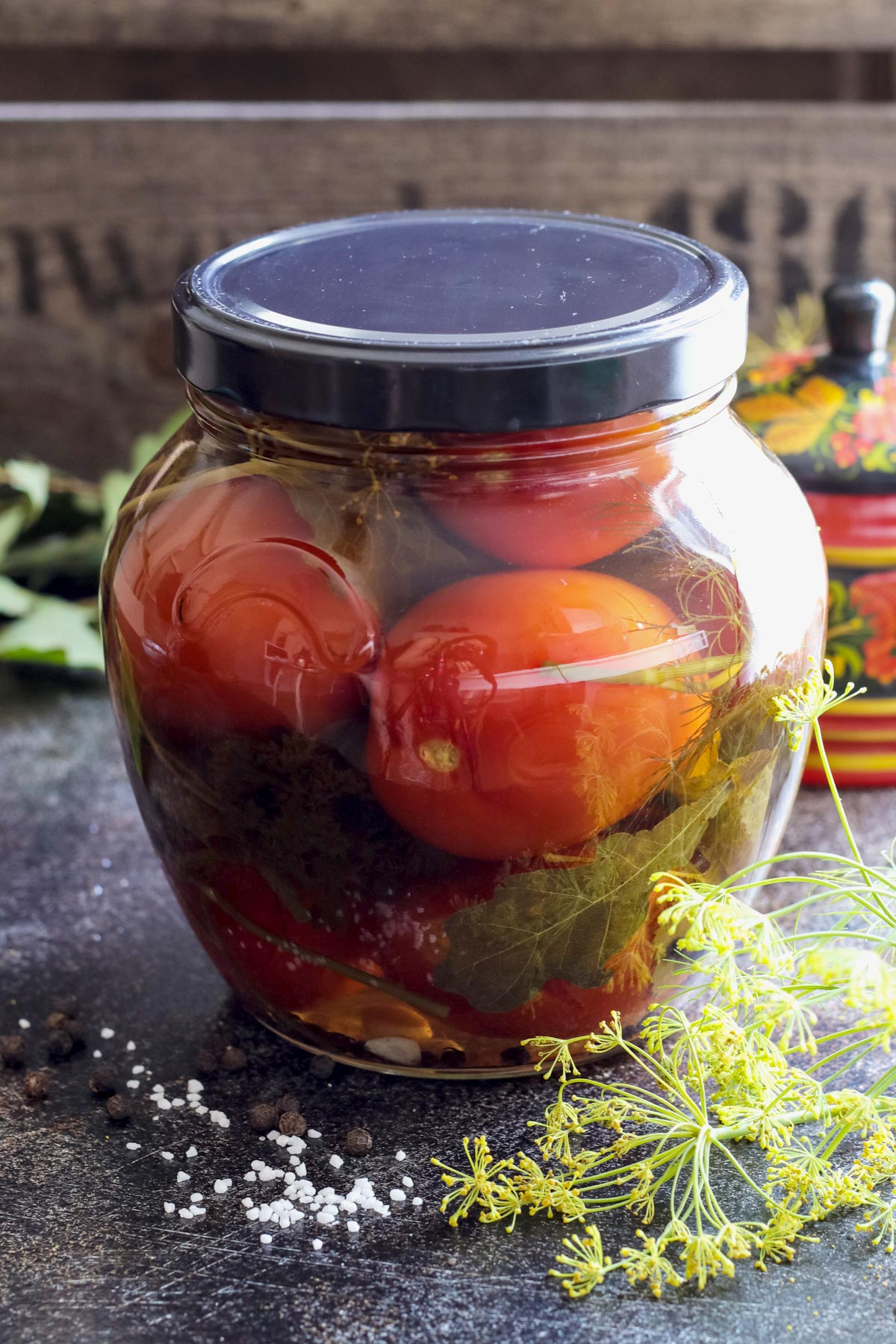 Sealed jar with Russian pickled tomatoes.