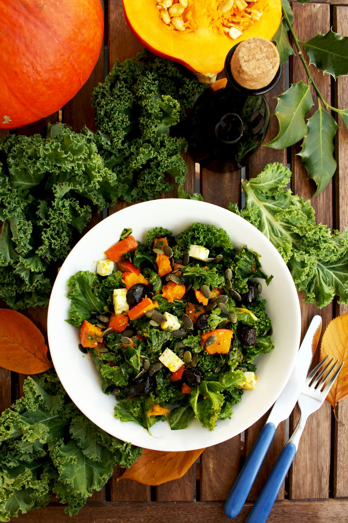 Kale Pumpkin Salad with Feta and Pesto Dressing: Easy-to-make, fast, healthy and delicious salad packed with fall flavors. Perfect seasonal salad!