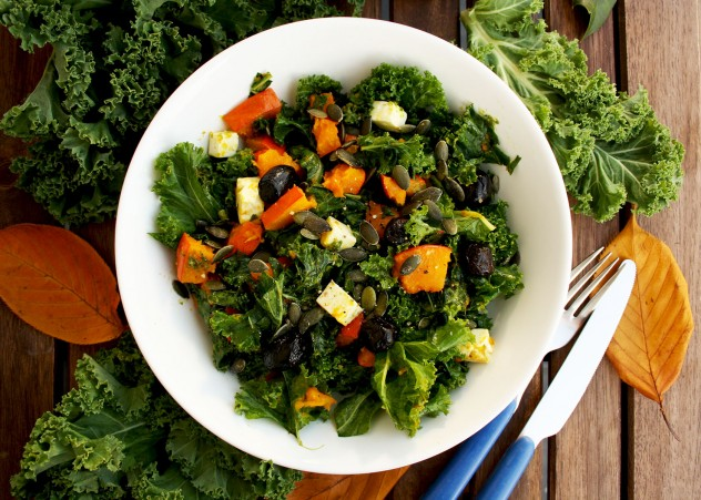 Kale Pumpkin Salad with Feta and Pesto Dressing - with Fall Leaves Decorating the Table