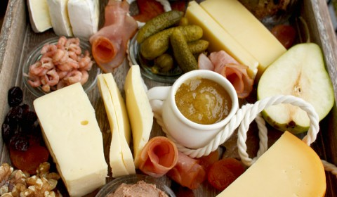 North German Cheese Plate and Easy Crackers Recipe: effortless and impressive appetizers and cheeses, rye crackers, meat, fish, fruit and nuts.