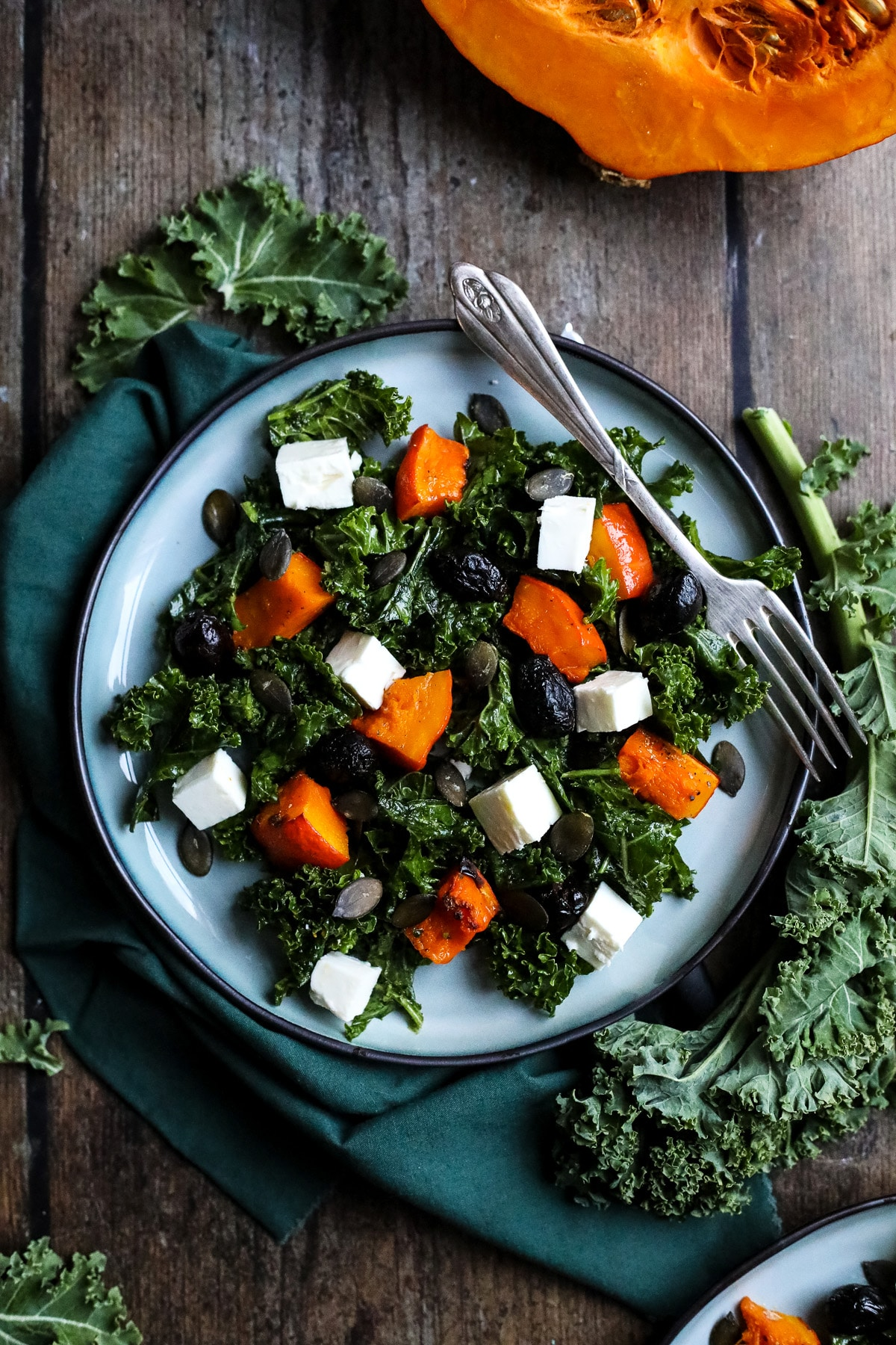 Kale pumpkin salad on a plate.