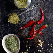 Tkemali Georgian Plum Sauce - Focus on Red Chili Peppers and Spices on the Dark Surface
