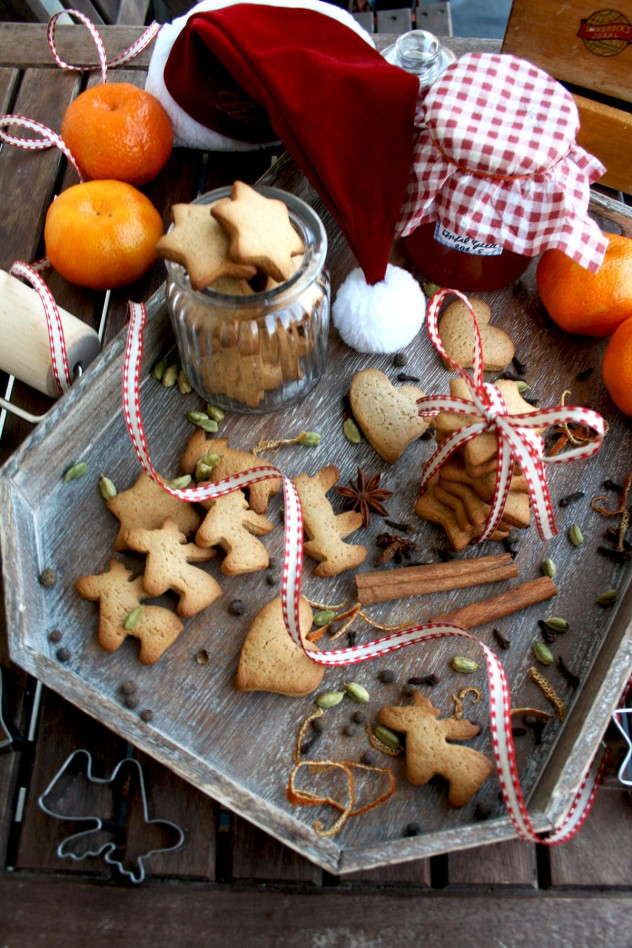 German Christmas Cookies - Lebkuchen - with Christmas Baking Tools and Oranges on the Table