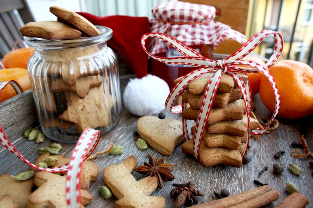 German Christmas Cookies - Lebkuchen - Lots of Cookies on the Table with Oranges and Santa Hat