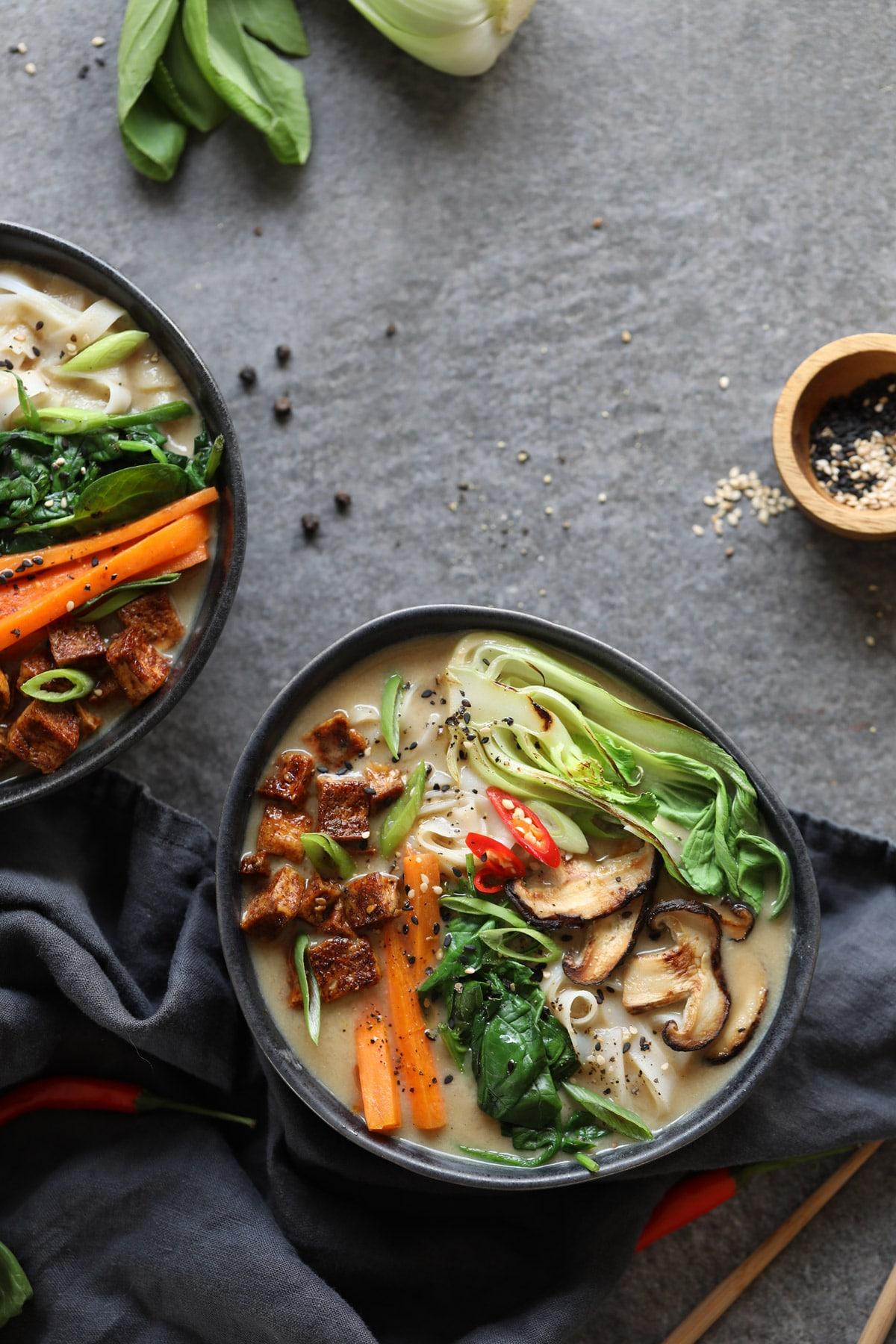 A bowl of vegan miso ramen with sesame seeds.