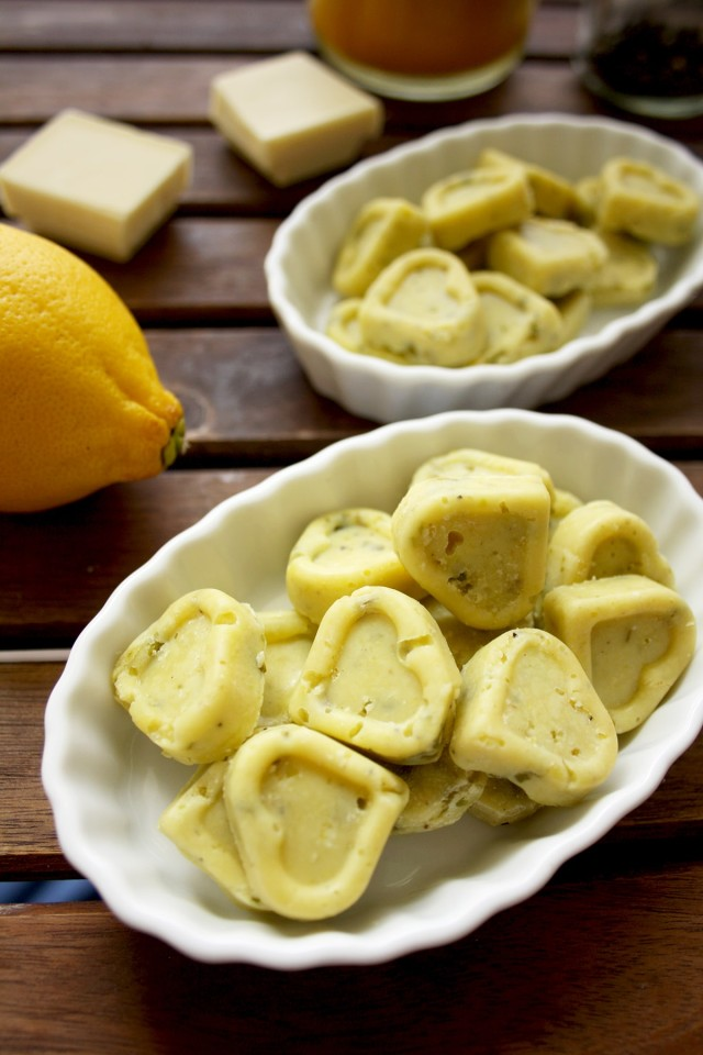 Three Chocolate Truffles Recipes - White Chocolate Hearts with a Lemon Next to Them on the Table