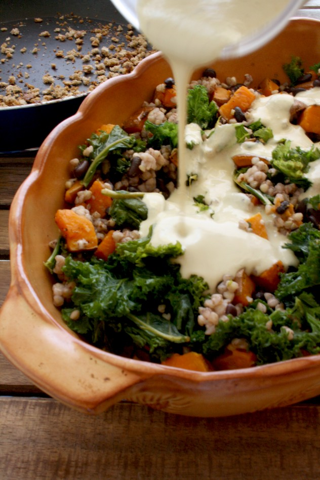 Comforting gluten-free vegan sweet potato casserole with black beans, kale buckwheat and roasted garlic sauce. Easy to assemble and perfect to make ahead.