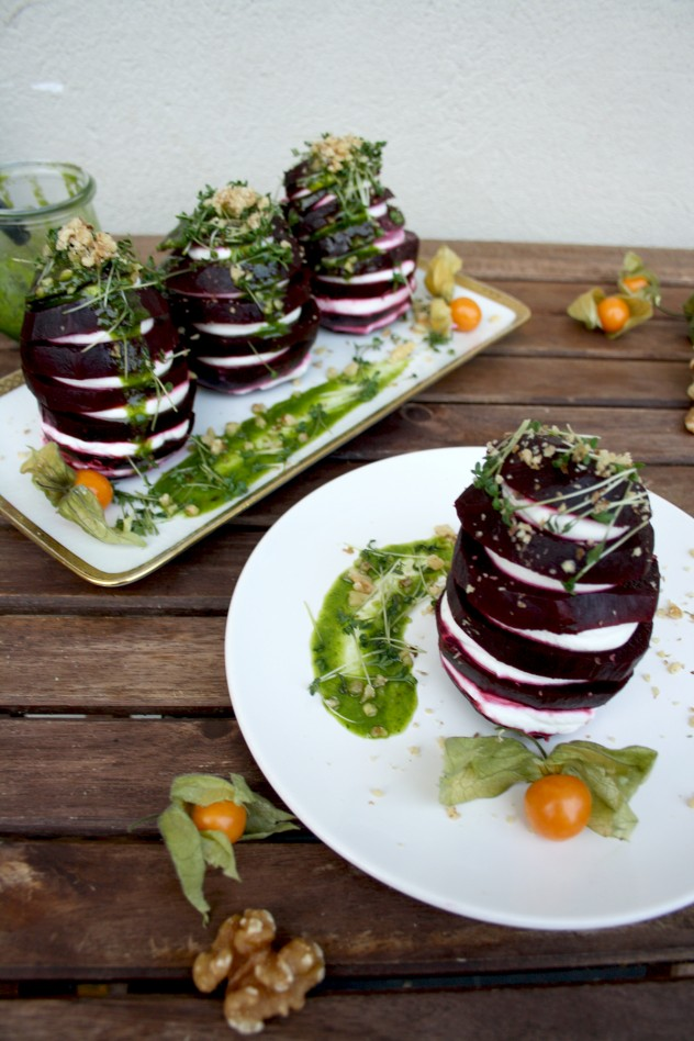 Beetroot Towers with Goat Cheese and Green Sauce Dressing: Impressive and fancy entrée ready in 10 minutes! Garnished with ground cherries, garden cress and walnuts.