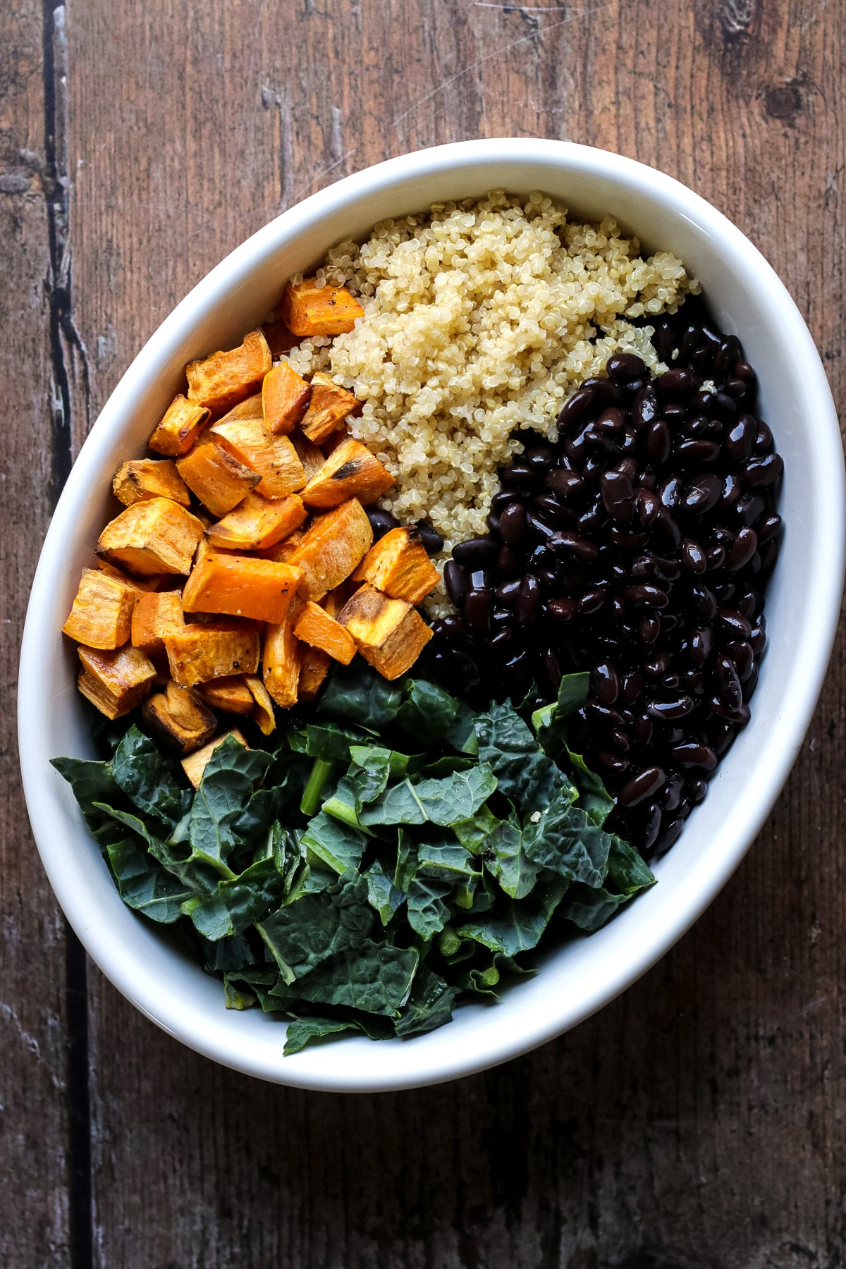 Sweet potato casserole with kale black beans and quinoa before adding the sauce.