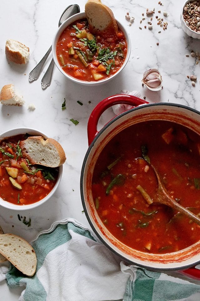 Vegan Minestrone Soup in a Pot and Bowls