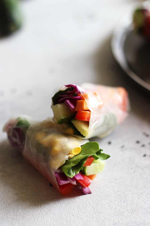 Fresh Vegan Spring Rolls Closeup on Two Rolls on the Table