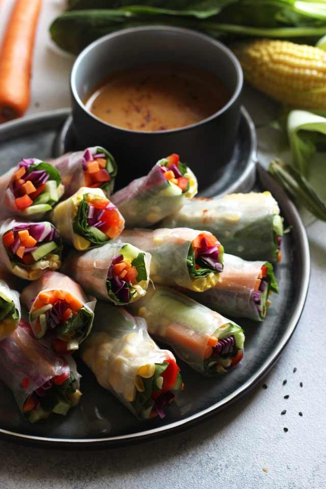 Easy Fresh Vegan Spring Rolls with Peanut Sauce: Satisfying, colorful and versatile snack loaded with veggies and dipped in delicious peanut sauce with ginger and garlic. Perfect healthy mess-free portable snack or appetizer everybody will love! Naturally gluten-free, raw and low carb.