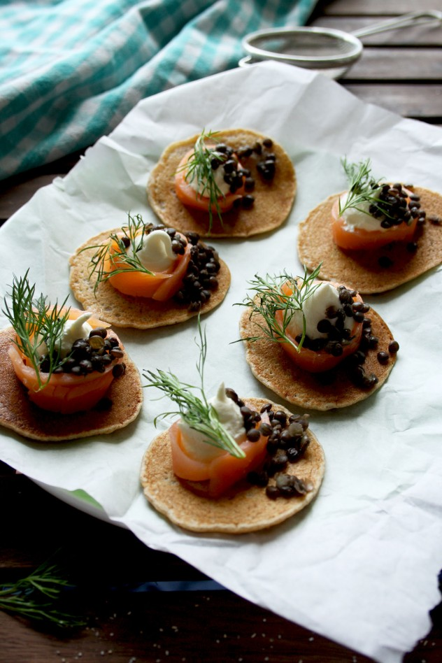 Healthy, gluten-free and delicious Russian style buckwheat pancakes made from only 5 ingredients in 20 minutes! Garnish them with smoked salmon, crème fraiche, beluga lentils and dill for a truly Russian flavor.