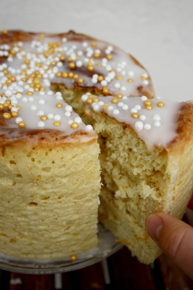 Kulich - Sweet Russian Easter Bread Taking One Piece Away