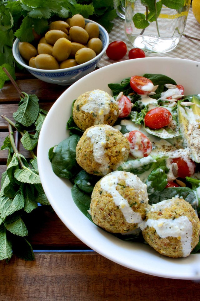 Crispy Baked Falafel with Hazelnuts and Creamy Lemon-Mint Sauce - Delicious Meal Served with Greens