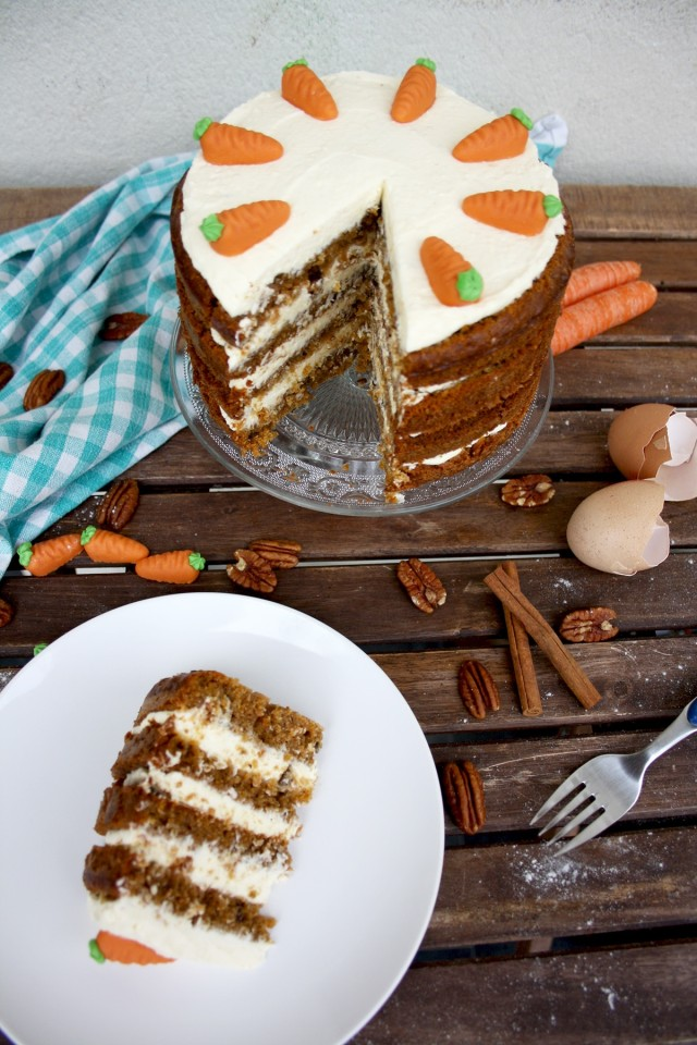 Super Moist Carrot Cake with Vanilla Cream Cheese Frosting - Serving on a White Plate