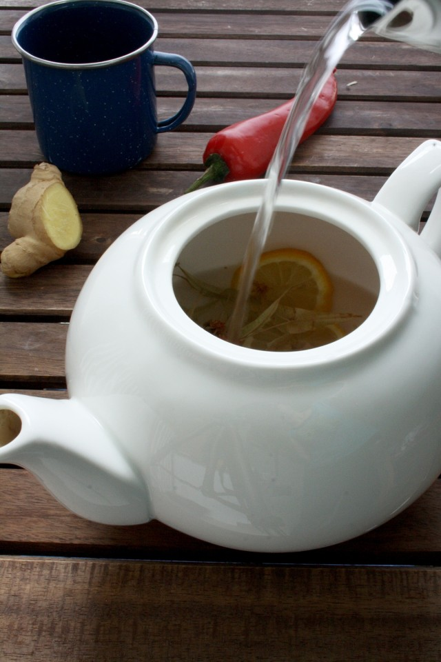 Natural Flu Remedy: Magic 4-Ingredient Tea Pouring Hot Water into the Pot