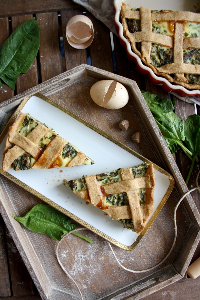 The Best Rustic Ricotta Spinach Quiche Served in Two Pieces on a Light Tray