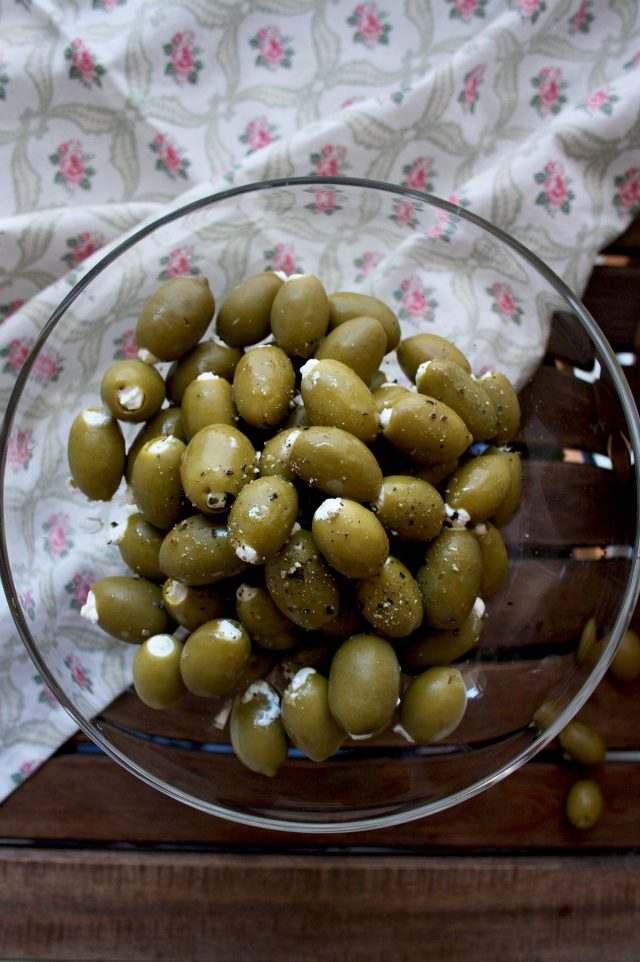Cream Cheese Stuffed Olives Overhead on a Glass Bowl Full of Olives