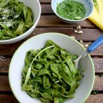 Easy Green Pesto Pasta with a Fork Inside One of the Bowls