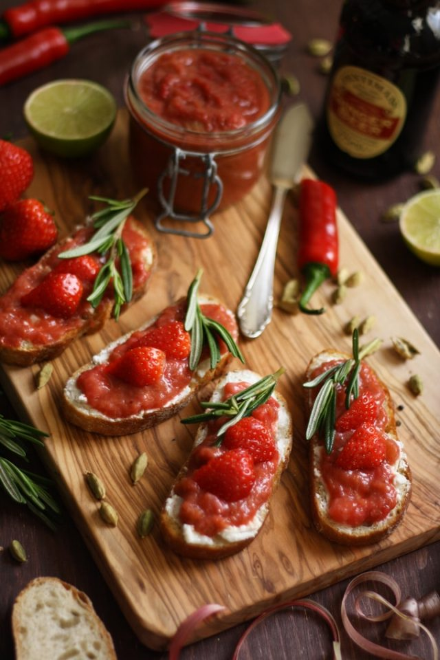 Goat Cheese Crostini with Rhubarb Chutney Beautiful Composition with Four Servings and Ingredients Around ont he Table