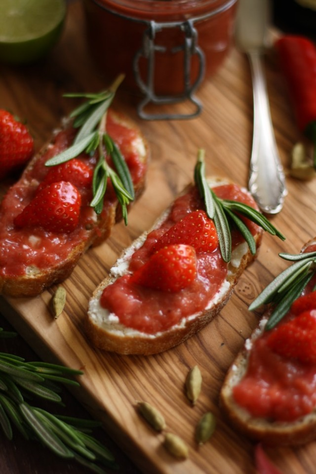 Goat Cheese Crostini with Rhubarb Chutney - Three Crostini in Line Decorated with Rosemary