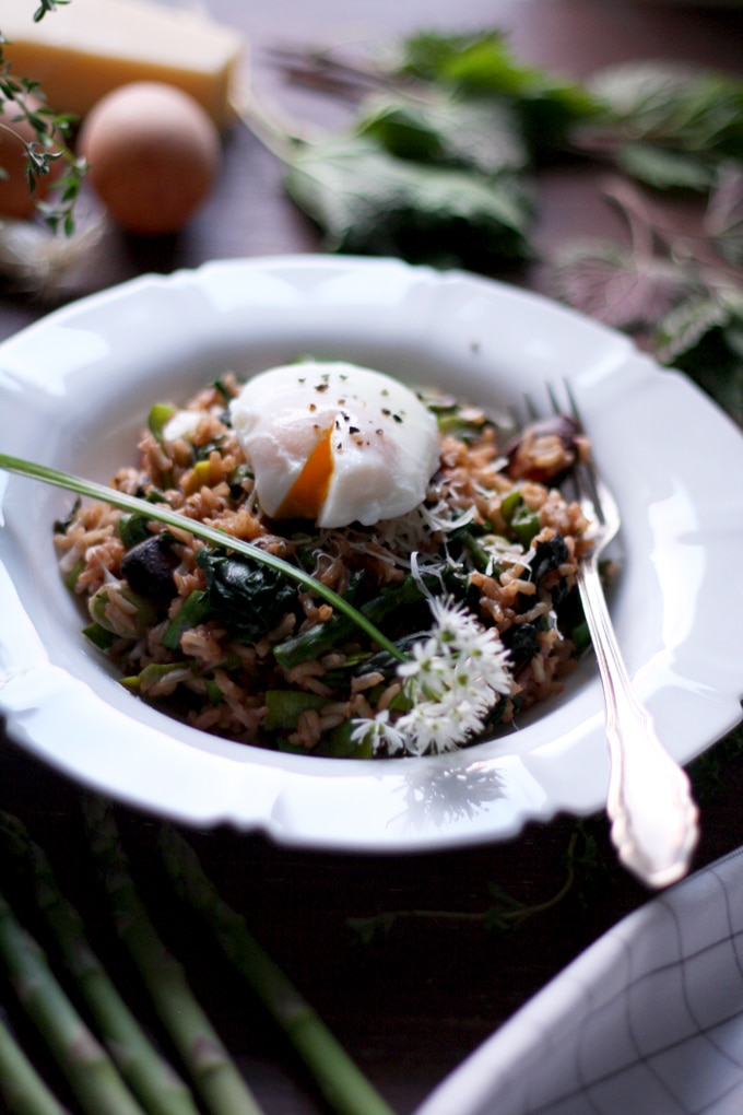 Spring Brown Rice Risotto with an Egg on Top in a White Plate