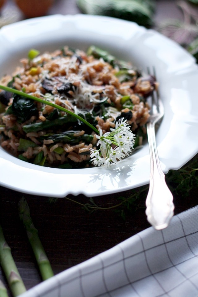 Spring Brown Rice Risotto in a Plate with a Flower on Top
