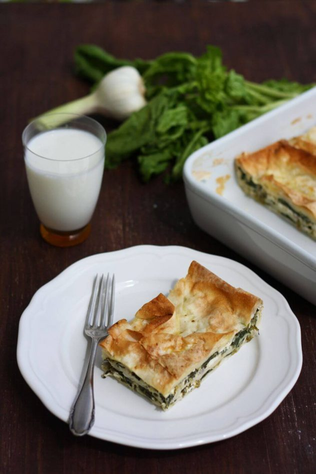 Turkish Boerek with Spinach and Feta Cheese Served with Milk on the Table