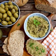 Olive Tapenade Dip with Some on the Bread Pieces, Shot from the Top
