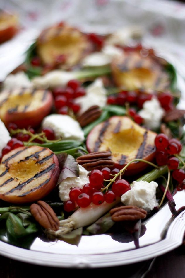 Gluten-free Summer Grilled Peach Salad recipe with beet greens, red currants, goat cheese, pecans and grilled scallions, topped with maple balsamic dressing
