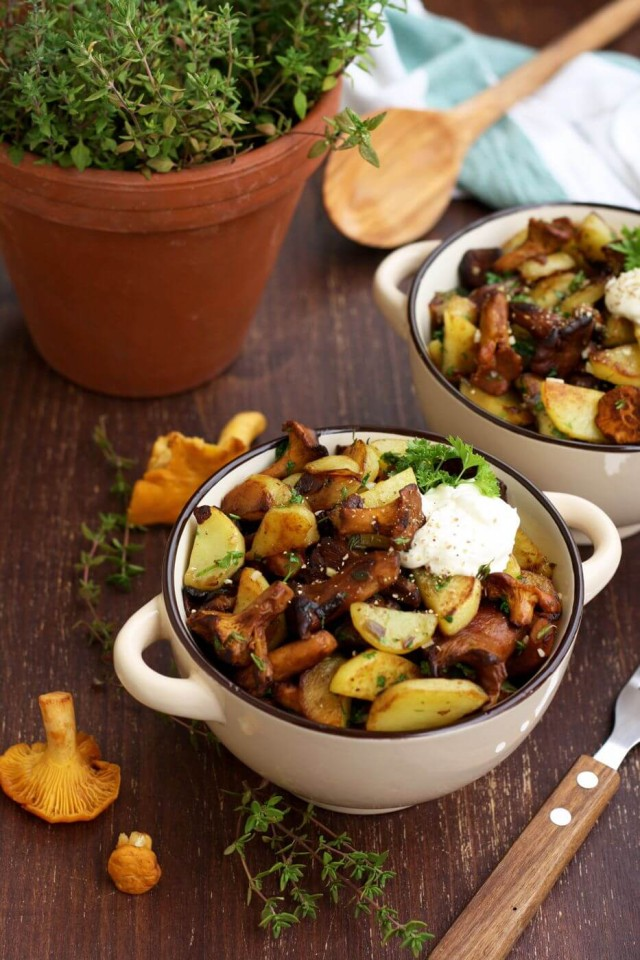 Russian Pan-Fried Potatoes with Wild Mushrooms Served with a Fork and a Spoon