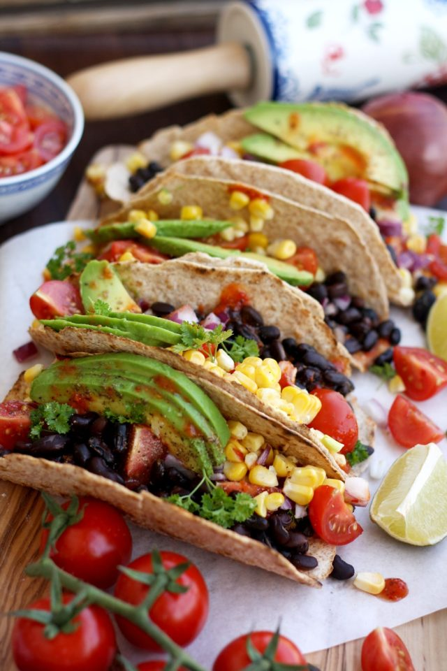 Vegan Tacos with Avocados, Corn and Black Beans in a Row