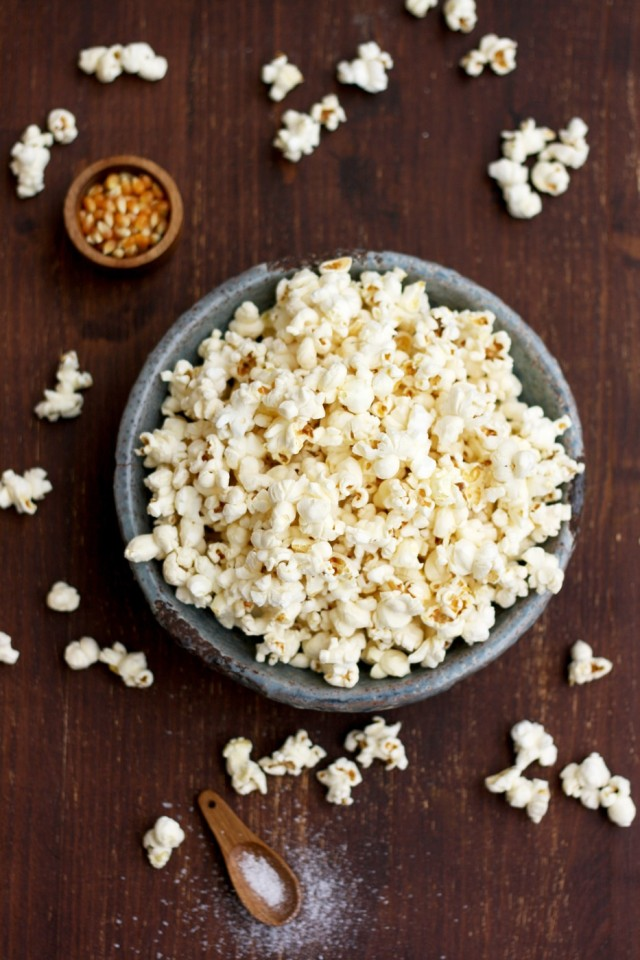 Always Perfect Stovetop Popcorn Overhead Shot with Raw Corn in a Tiny Little Bowl