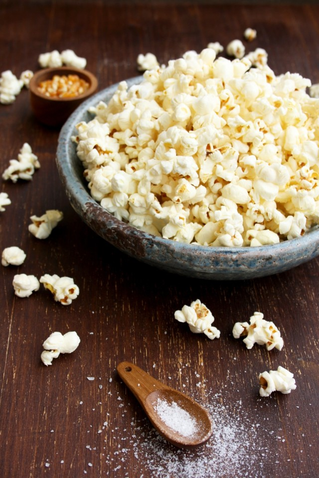 Always Perfect Stovetop Popcorn Bowl with Popcorn Around on the Table