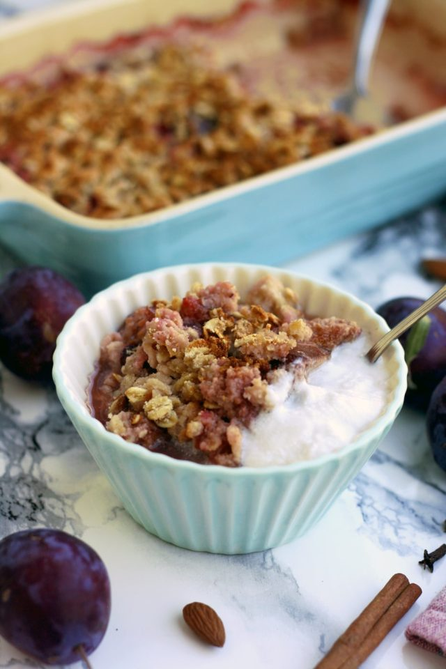 Delicious, vegan and gluten-free plum crisp with coconut makes for a great healthy dessert or breakfast. Easy 45-minute recipe from start to finish!