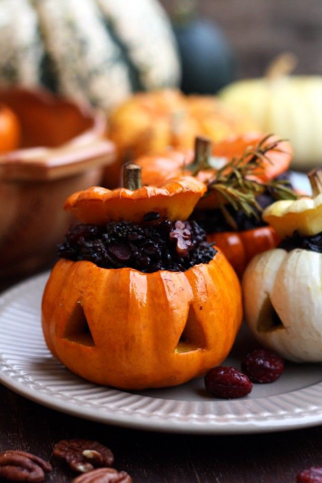 Easy Halloween carved pumpkins with wholesome wild rice stuffing. Serve these spooky kid-friendly stuffed pumpkins for a healthy holiday treat!