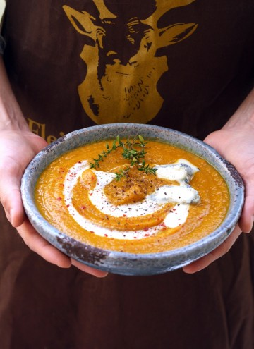 Roasted Butternut Squash Soup - Holding in Hands in a Bowl