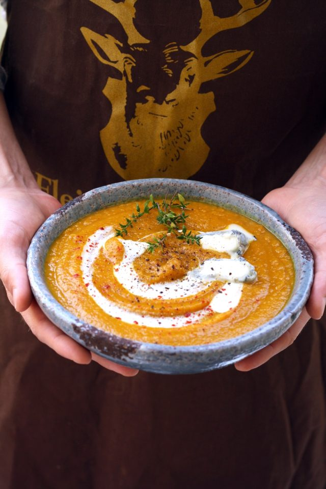 Creamy, flavorful and rich roasted butternut squash soup with carrots and garlic recipe. Add goat cheese to this easy vegan soup to make it extra delicious!