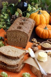 Healthy Pumpkin Bread with Walnuts - Delicious Butter Ready to Be Spread All Over the Bread Pieces